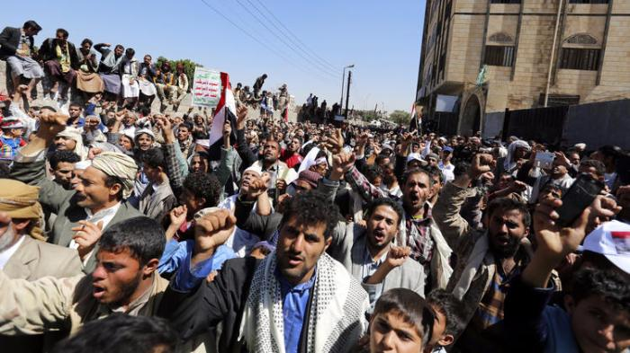 Yemenis shout slogans during a rally in Sana on Monday protesting Saudi-led airstrikes that hit a funeral hall. (Yahya Arhab / European Pressphoto Agency)